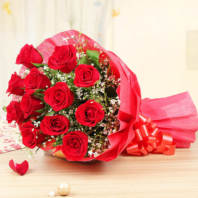 Side view of 12 red roses in Chocolicious Roses Combo