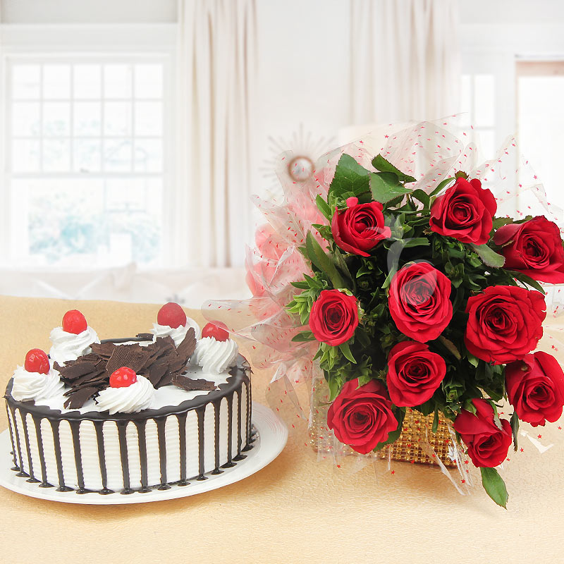 Lovingly Yours - Combo of 10 red roses with half kg black forest cake