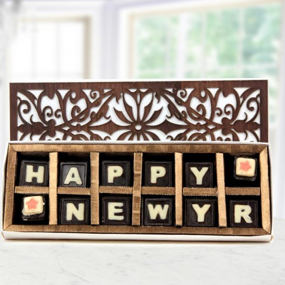 12 pieces of delectable handmade chocolates displaying Happy New Year