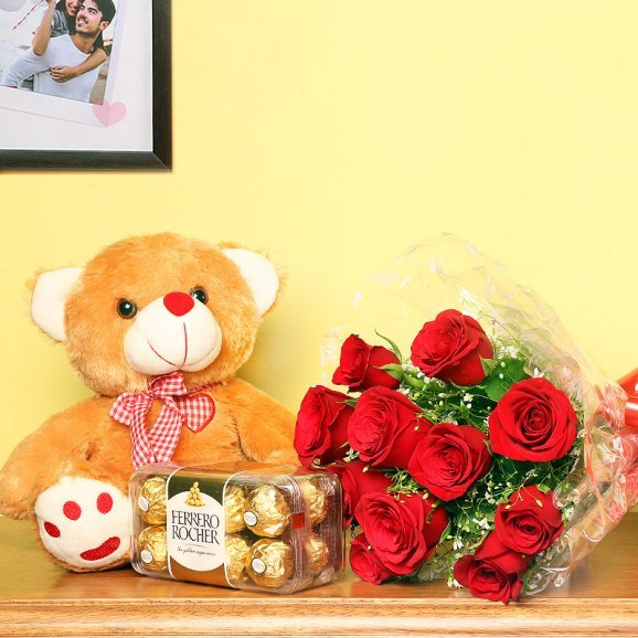 Serene Love Combo - A gift hamper of 12 red roses with 1 teddy and 16 Ferrero Rocher