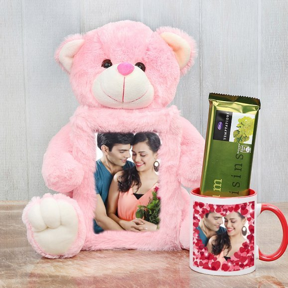 Pink teddy with anniversary frame alongwith cadbury and mug