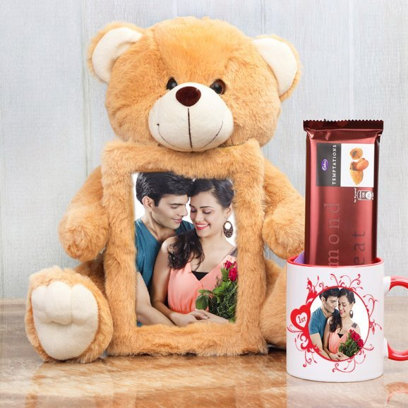Brown teddy with anniversary frame alongwith cadbury and mug