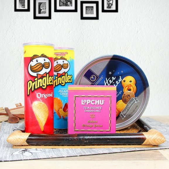 Gourmet hamper of pringles and butter cookies alongwith tea