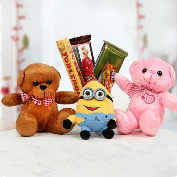 two 6 inch teddy bear, 3 inches minion, A Toblerone , 2 Cadbury Temptations, 1 Champagne-shaped handmade chocolate