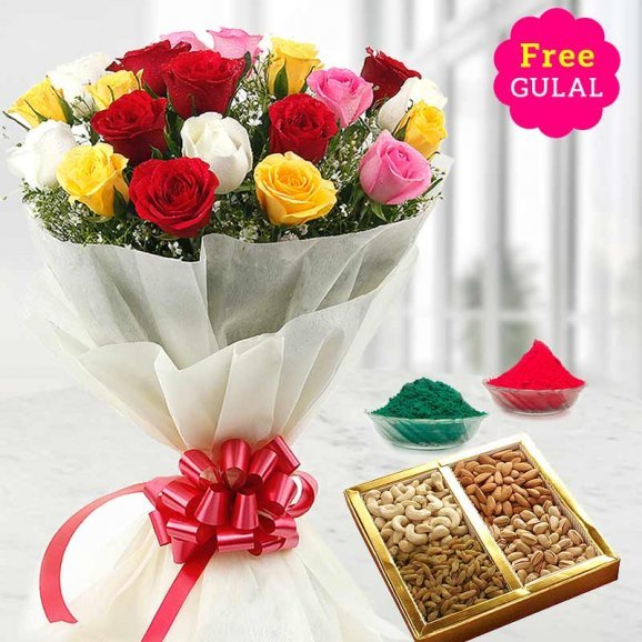 Yellow, white, red and pink flowers bunch with dry fruit and gulal for Holi
