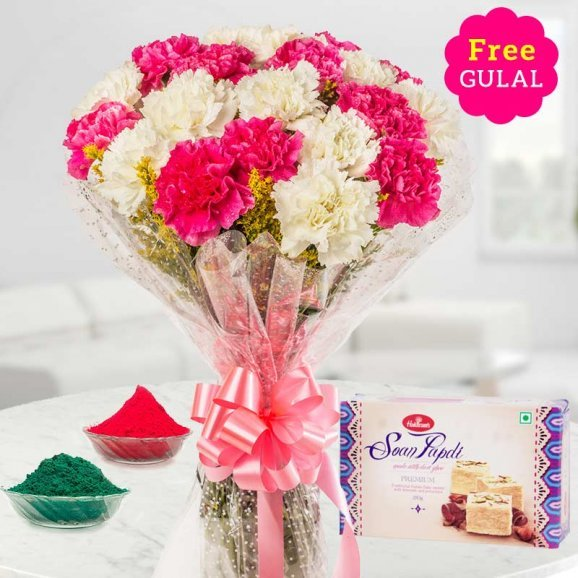 White and red flower bunch with Soan Papdi and gulal for Holi