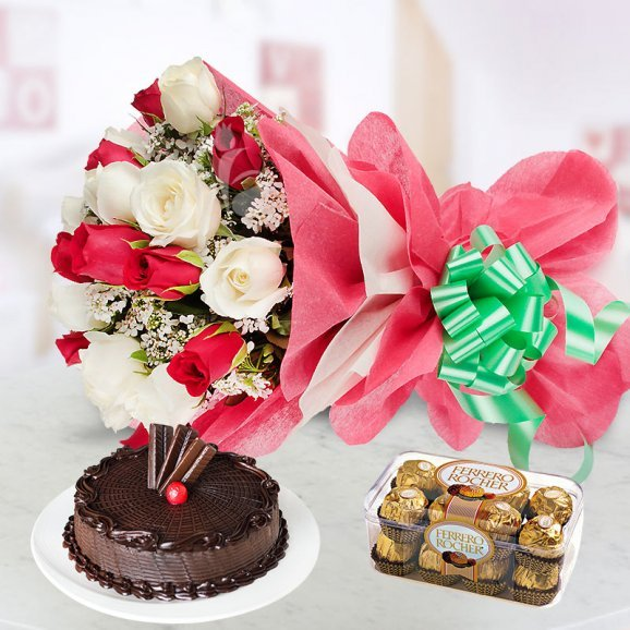 Jingle Bells - A gift hamper of 20 Red and White Roses bunch and 16 Ferrero Rochers with half kg chocolate cake