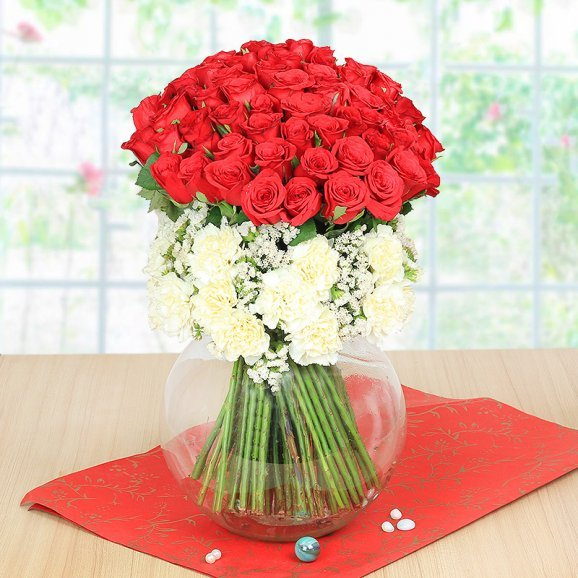 50 Red Roses and 15 White Carnations in Glass Vase