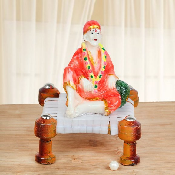 Spritual Master Sai Baba on Chowki in Red Clothes