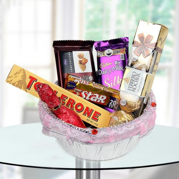 Chocolate hamper of Almond Flavoured Temptation, Dairy Milk Silk, a pack of 5 Ferrero Rocher, 5-Star, Toblerone and Champagne shaped Handmade Chocolates.
