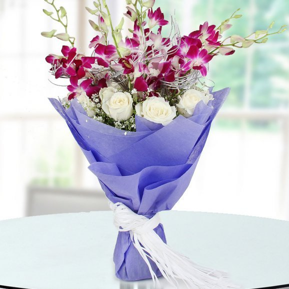 Bunch of 6 Orchid and 12 white roses on Table