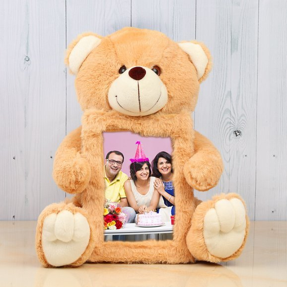 Brown teddy with birthday frame