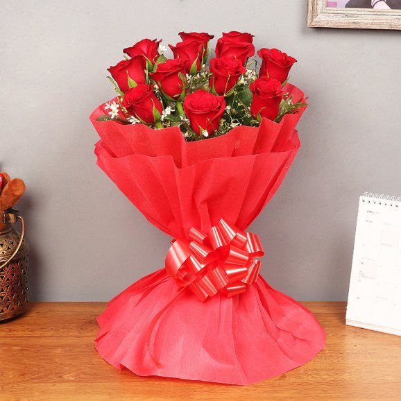 Beautifully packed bunch of 12 red roses