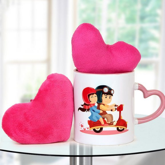 Two heart shaped pink cushions and You and Me Perfect Love Story Coffee Mug