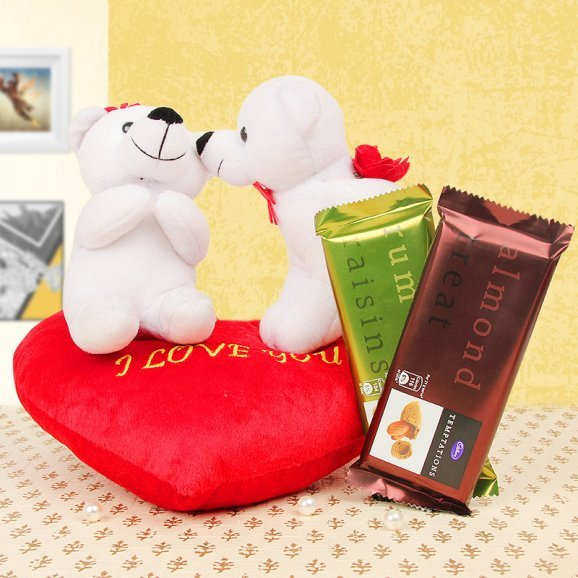 White teddy couple with 2 cadburies