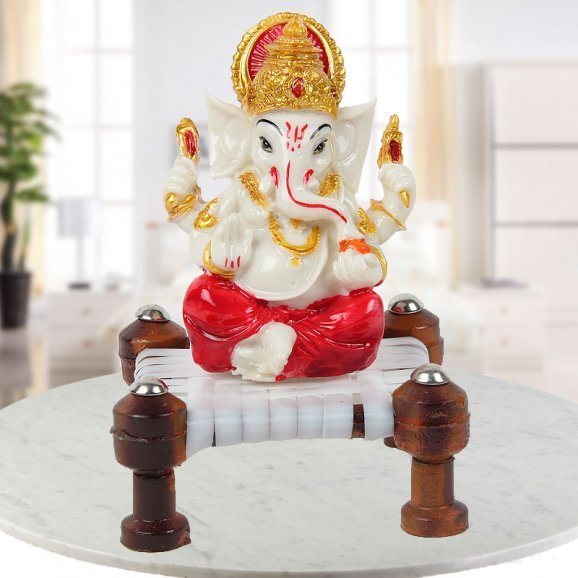 cute little Ganesha Idol on chowki