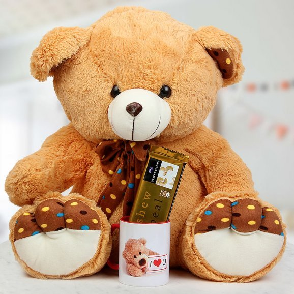 A 24 Inch Brown Teddy A Coffee Mug and one Temptation Cashew Appeal