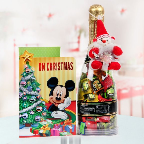 Pretty Christmas card with champagne shaped bottle filled with sweet candies and an ever so jolly miniature Santa Claus