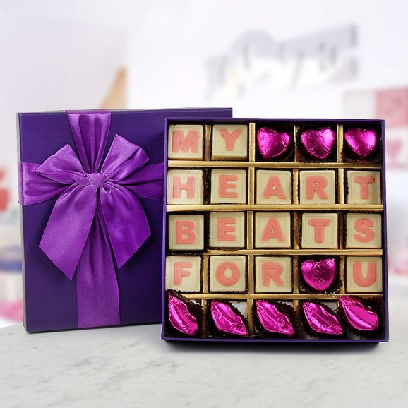 A box of 25 handmade white chocolate with a message My Heart Beats For You
