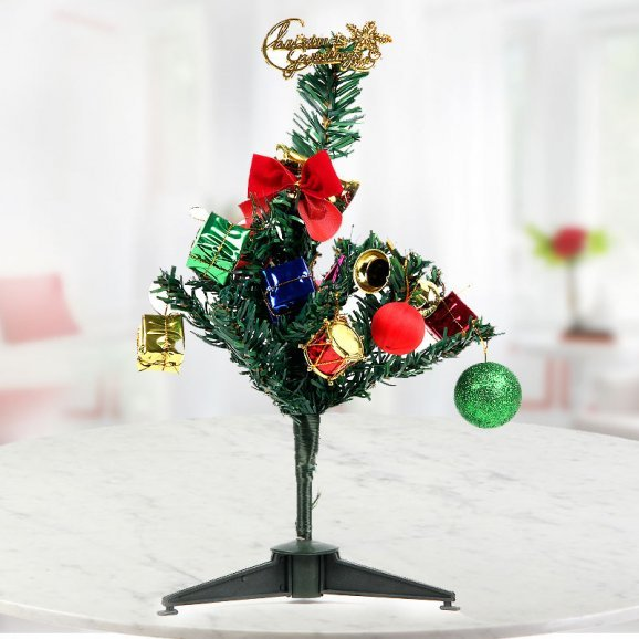 A 12 inch Christmas tree adorned with lovely decorative ornaments