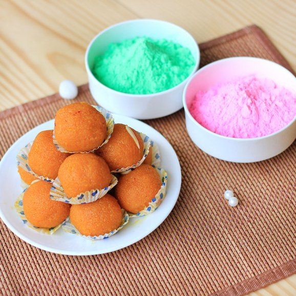 A combo having pack of Motichoor Laddoo and two packs of Gulal