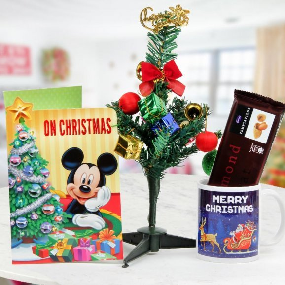 Combo of Christmas greeting card, a 1 feet embellished Christmas tree, 1 pack of Temptations and a Merry Christmas Mug