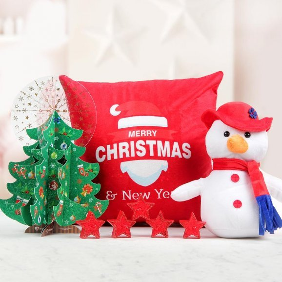 6 inches cuddly Snowman with an Archies Christmas Tree card, 5 aromatic candles and a 12x12 inches cushion
