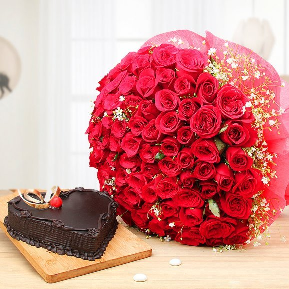 Deluxe Celebrations - 100 red roses bunch and half kg heart shaped chocolate cake combo