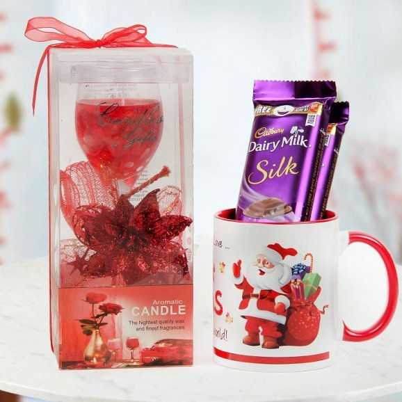 A lavish scented candle, 2 Dairy Milk Silk and a Happy Santa Mug - A delightful combo of Christmas
