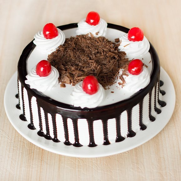 Front view of half kg Blackforest cake - A gift of Expressions Of Endearment combo