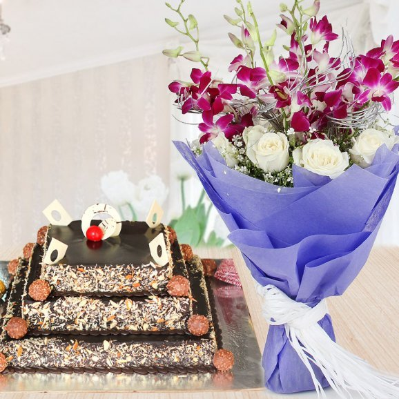 3 tier ferrero rocher cake with bouquet of soulful lilies and pure white roses