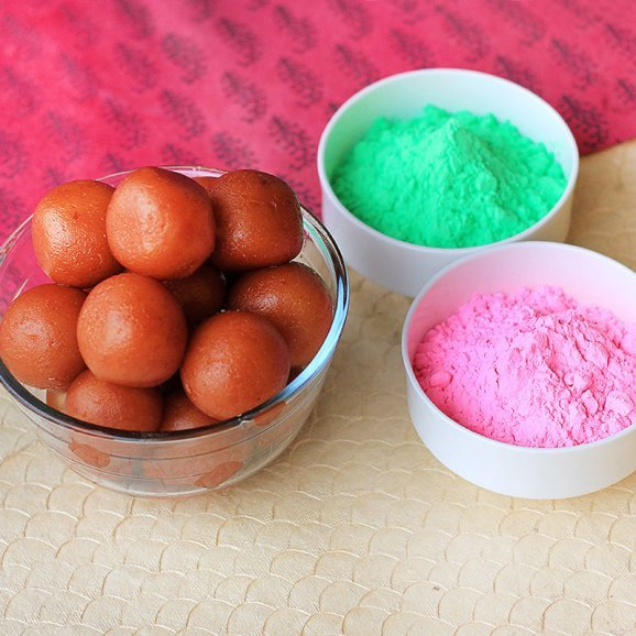 A combo of bright and vibrant herbal Gulal and A pack of Gulabjamun