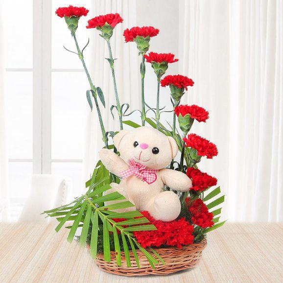 Bouquet of 12 red carnations with a teddy - First gift of Flawless Rose Delight Combo