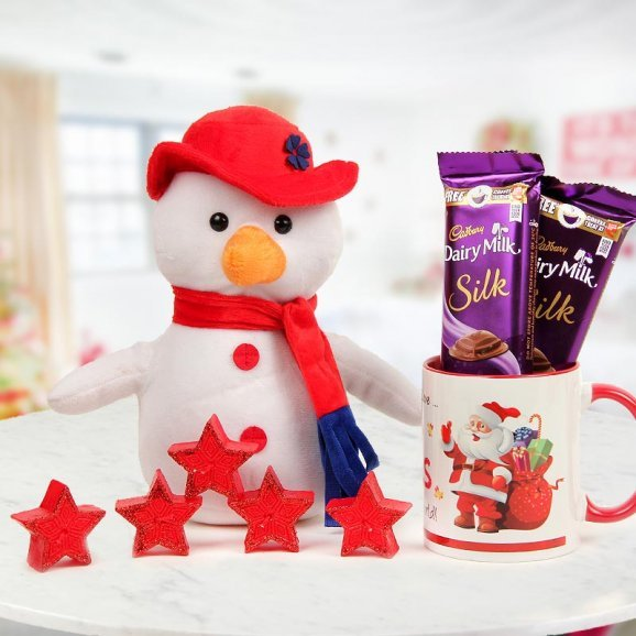 Combo of 6 inches Snowman, a Happy Santa Mug, 5 aromatic candles and 2 Dairy Milk Silk
