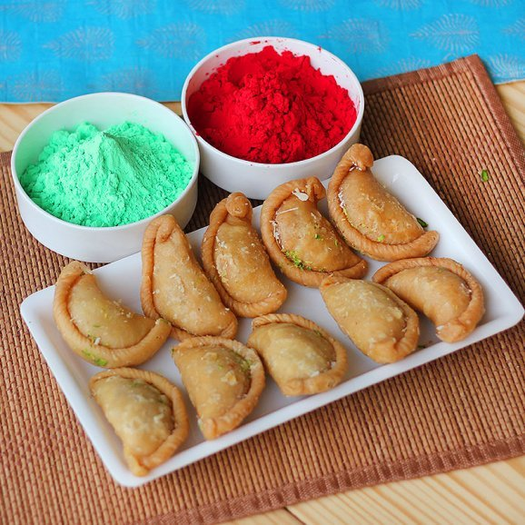 A Holi combo with delicious Gujias and Red Green Gulal