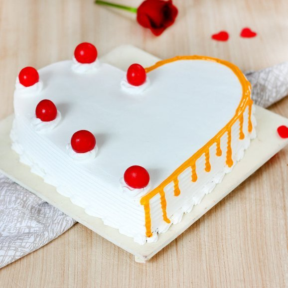 Heart Shaped Vanilla Cake With Cherries On Top