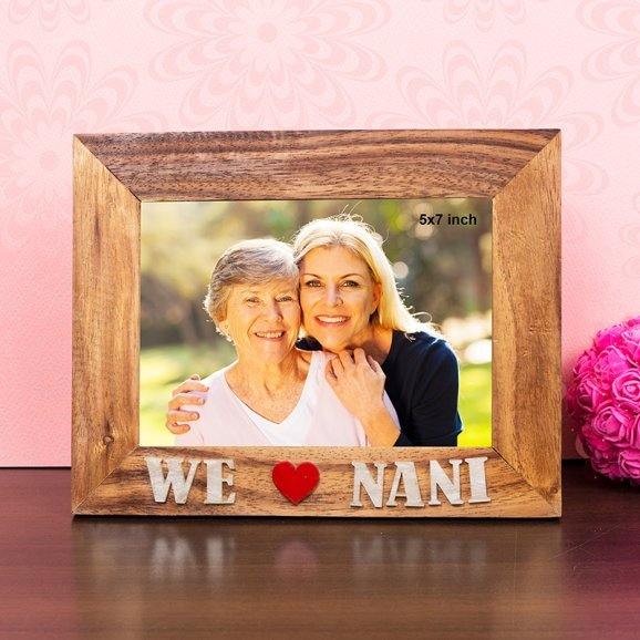 We love Nani 7X9 Inch Wooden Table Top Photo Frame