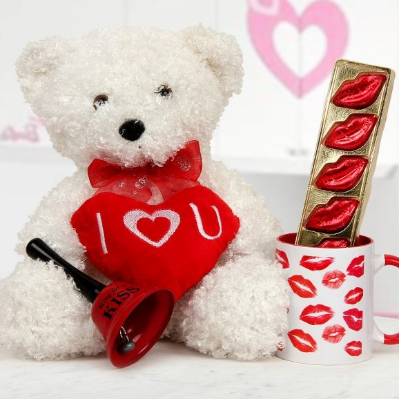 A 8 inches Teddy A pack of handmade chocolates A Coffee Mug and Ring for A Kiss bell