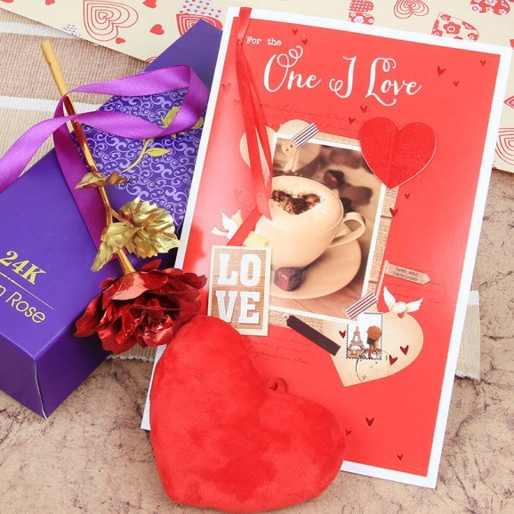 A combo of artificial rose with a card and small heart