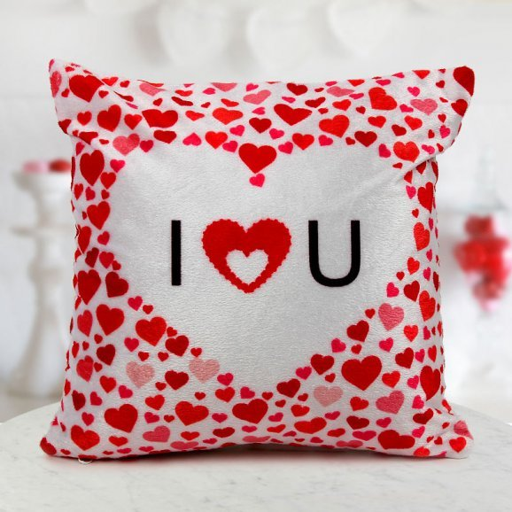 A 12x12 white and red heart printed cushion for your loved ones