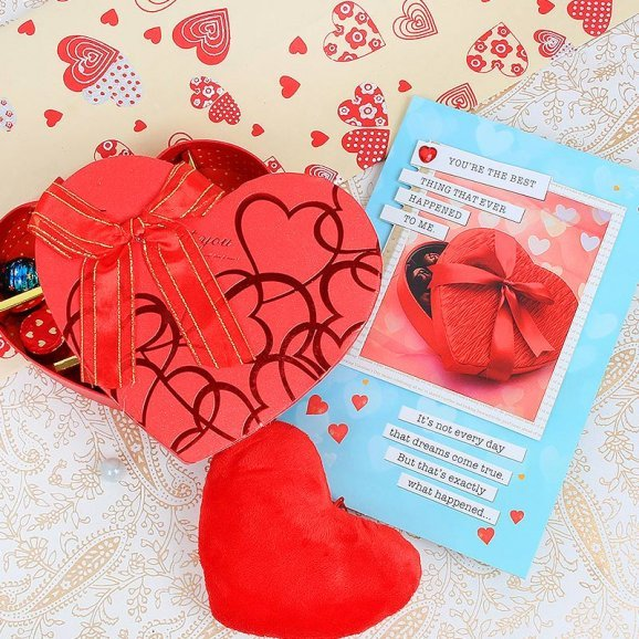 Combo of a card and handmade chocolates with a small heart