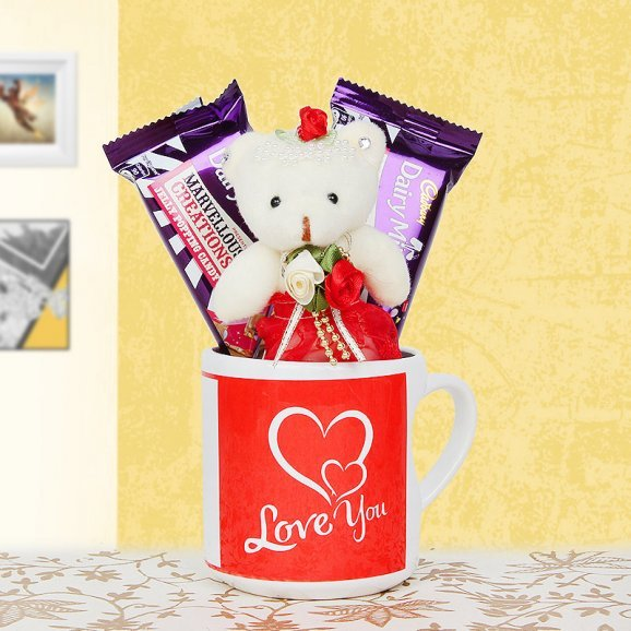 A Mug and a Teddy with Two Chocolates