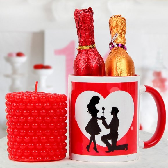 A Be My Valentine coffee Mug A two champagne-shaped handmade chocolates and A pearl red aromatic candle