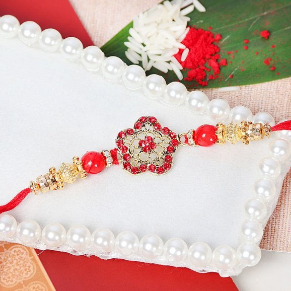 Metalic Floral Shaped Rakhi