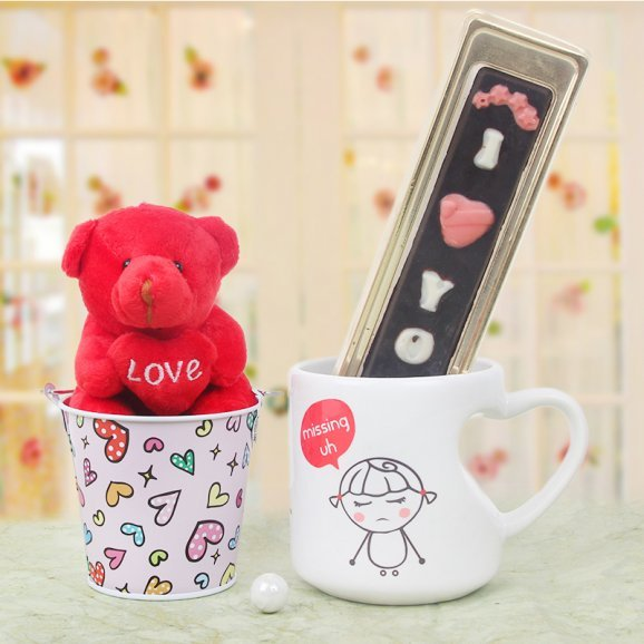Teddy and chocolates with a mug