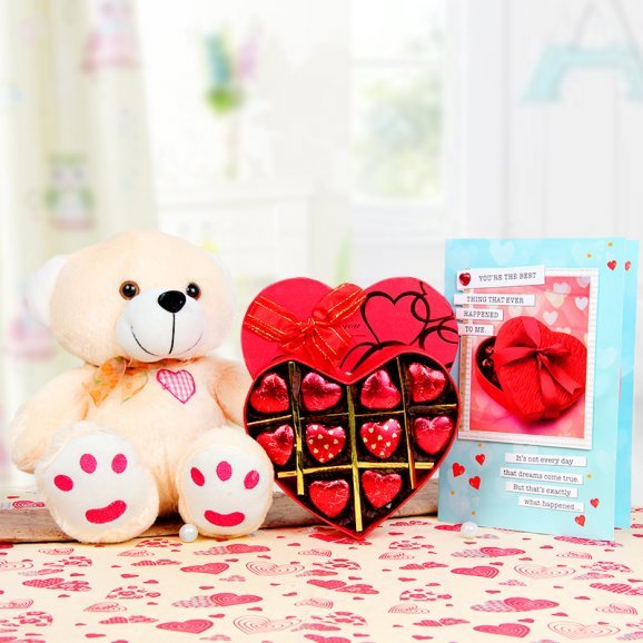 A greeting card with handmade chocolates and a teddy