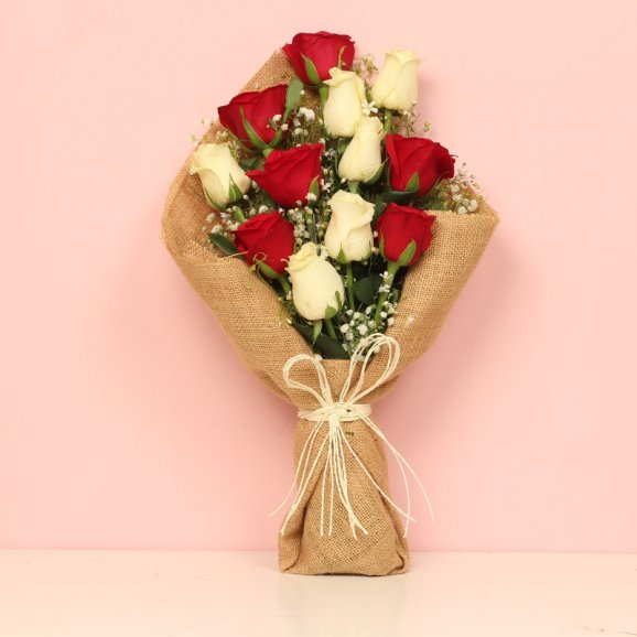 Bunch of Red and White Roses in Jute Packing