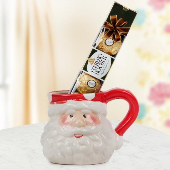 A Santa Special Coffee Mug and a pack of Ferrero Rochers chocolate