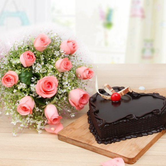 Pinkalicious Chocolate Delight - 10 Pink roses bouquet and 1 kg heart shaped chocolate cake