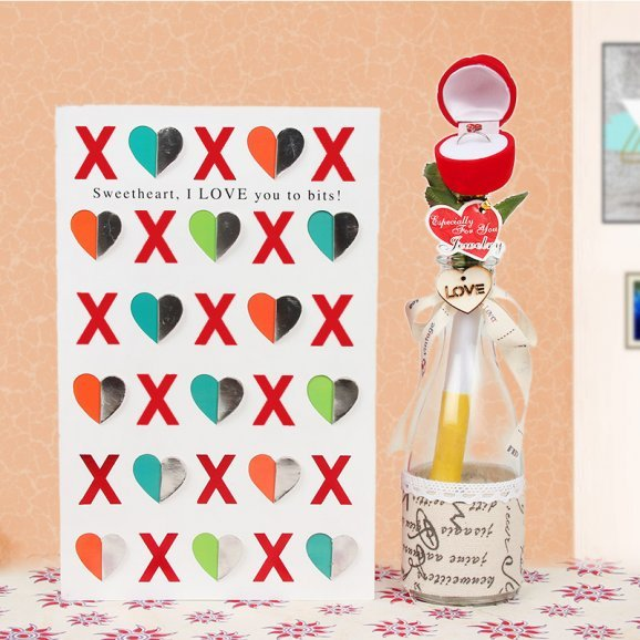 A card and a propose bottle with a rose and a ring combo